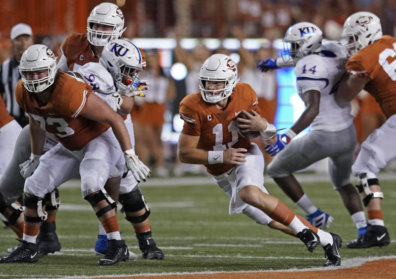 Texas' Sam Ehlinger (11) runs for a long gain against Kansas during the first half of an NCAA college football game in Austin, Texas, Saturday, Oct. 19, 2019. (AP Photo/Chuck Burton)