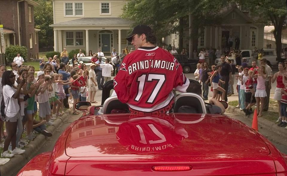 Hurricanes captain Rod Brind'Amour rides in a red convertible as the victory parade for the Stanley Cup Champions begins at St. Mary's School on St. Mary's Street on June 21, 2006.