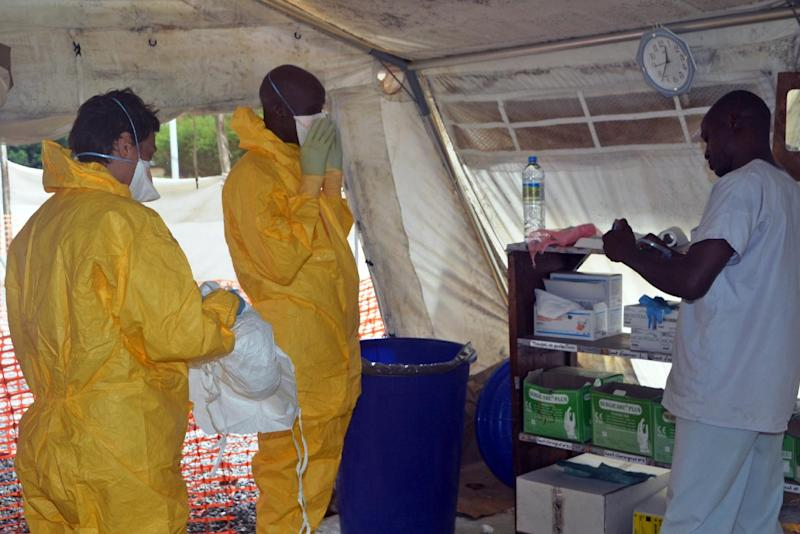 Medics put on protective gear at the isolation ward of the Donka hospital, on July 23, 2014 in Conakry, where patients are being treated for Ebola (AFP Photo/Cellou Binani)