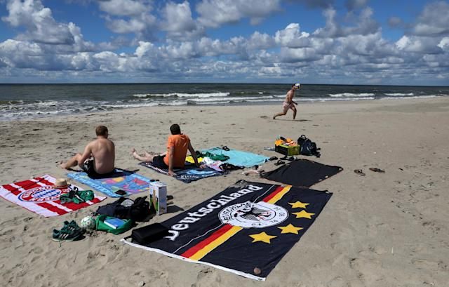 German fans enjoy the beach at Yantarny, Kaliningrad, Russia, June 23, 2018. As well as shooting all the matches, Reuters photographers are producing pictures showing their own quirky view from the sidelines of the World Cup. REUTERS/Mariana Bazo