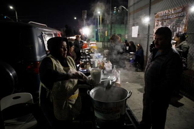 A food vendor of more than a decade serves pozole from a sidewalk grill in February in Boyle Heights, Los Angeles. (Photo: Patrick T. Fallon for Yahoo News)