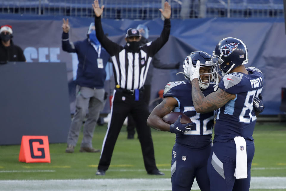 Tennessee Titans running back Darrynton Evans celebrates after scoring with tight end MyCole Pruitt during the second half of an NFL football game against the Detroit Lions Sunday, Dec. 20, 2020, in Nashville, N.C. (AP Photo/Ben Margot)