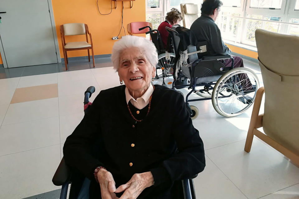 """In this photo taken on April 6, 2020, 103-year-old Ada Zanussi, poses for pictures at the nursing home """"Maria Grazia"""" in Lessona, northern Italy, after recovering from Covid-19 infection. To recover from coronavirus infection, as she did, Zanusso recommends courage and faith, the same qualities that have served her well in her nearly 104 years on Earth. The new coronavirus causes mild or moderate symptoms for most people, but for some, especially older adults and people with existing health problems, it can cause more severe illness or death. (Residenza Maria Grazia Lessona via AP Photo)"""