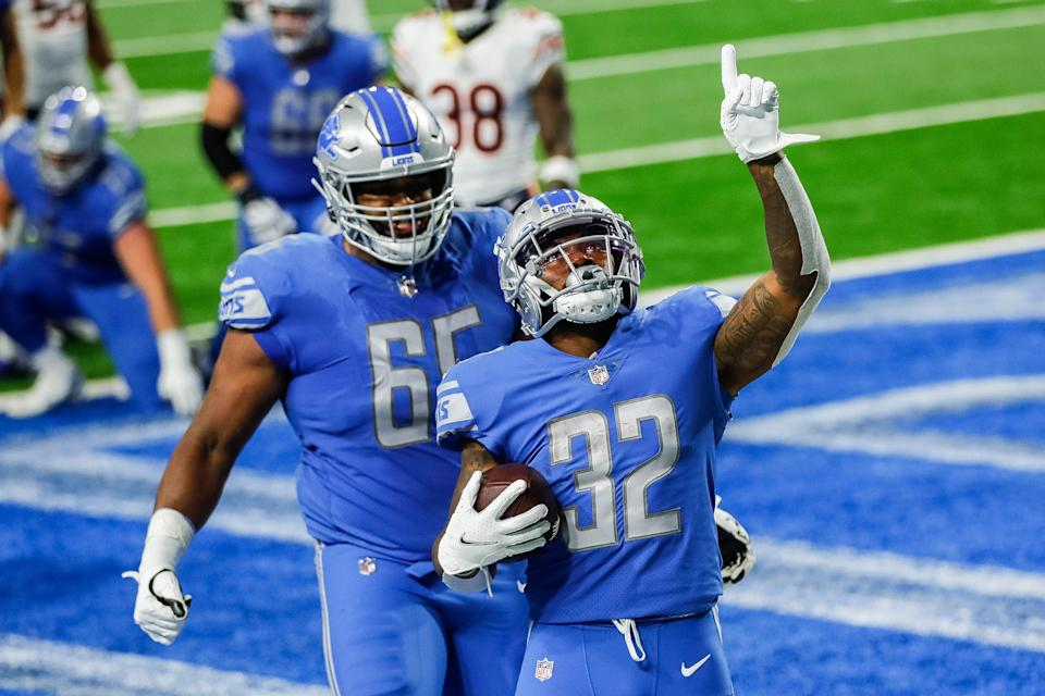 Lions running back D'Andre Swift celebrates his touchdown against the Chicago Bears during the first half of the season opener at Ford Field on Sunday, Sept. 13, 2020.