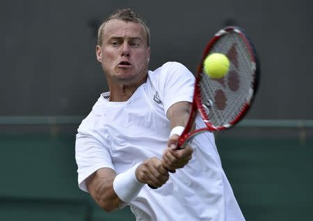 Lleyton Hewitt of Australia hits a return to Michal Przysiezny of Poland during their men's singles tennis match at the Wimbledon Tennis Championships, in London June 24, 2014. REUTERS/Toby Melville