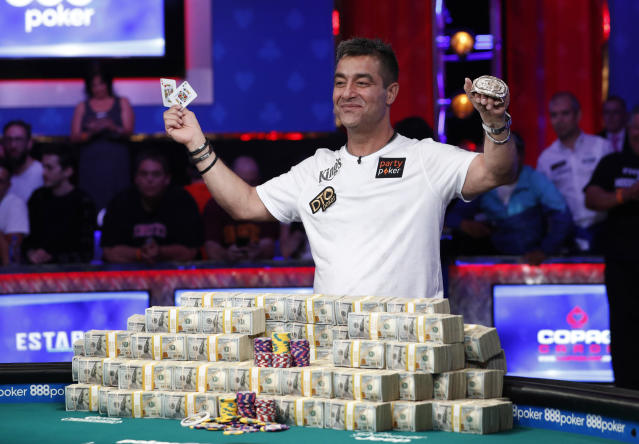 Hossein Ensan, of Germany, poses with the bracelet after winning the World Series of Poker main event Wednesday in Las Vegas. (AP Photo/John Locher)