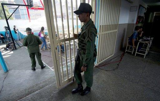 <p>Members of the Venezuelan Army stand guard at a polling station during state elections, in Caracas on December 16, 2012. Venezuelans voted Sunday in state elections overshadowed by President Hugo Chavez's latest and seemingly toughest battle against cancer.</p>
