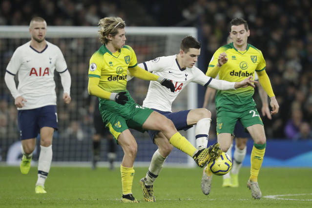 Tottenham's Giovani Lo Celso, right, fights for the ball with Norwich City's Todd Cantwell during the English Premier League soccer match between Tottenham Hotspur and Norwich City at the Tottenham Hotspur Stadium in London, England, Wednesday, Jan. 22, 2020. (AP Photo/Matt Dunham)