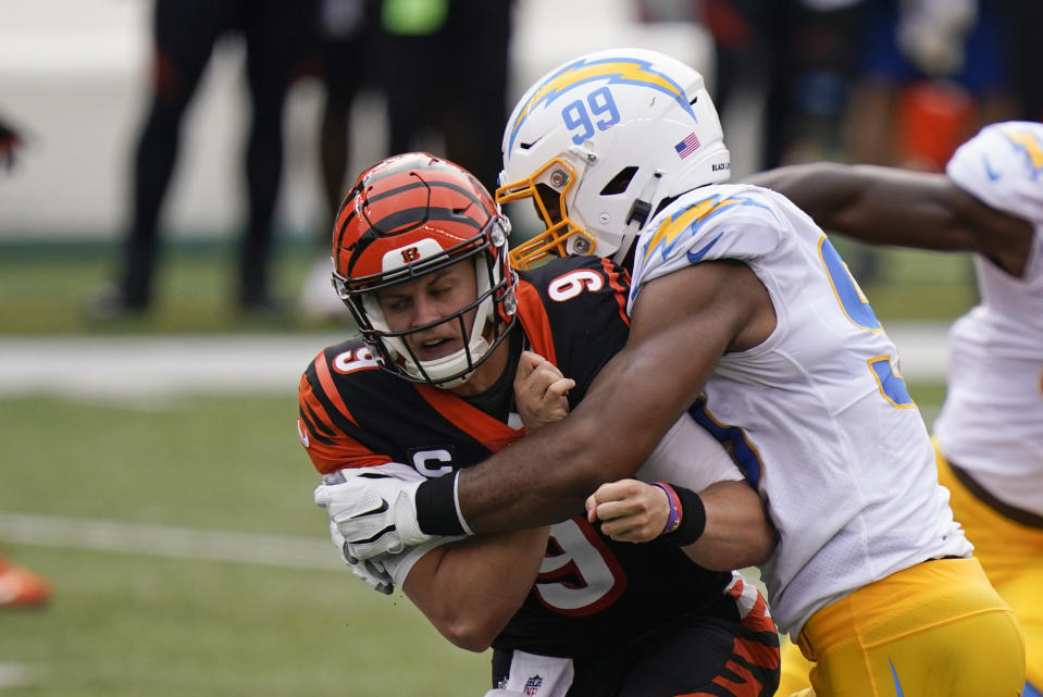 Cincinnati Bengals quarterback Joe Burrow was hit far too many times by the Los Angeles Chargers. (AP Photo/Bryan Woolston)