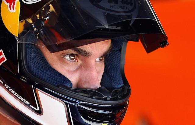 INDIANAPOLIS, IN - AUGUST 27: Dani Pedrosa #26 of Spain looks out from the pit garage during Moto GP practice at Indianapolis Motorspeedway on August 27, 2011 in Indianapolis, Indiana. (Photo by Jamie Squire/Getty Images)