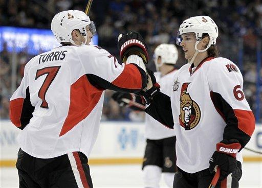 Ottawa Senators center Kyle Turris (7) celebrates with defenseman Erik Karlsson (65), of Sweden after scoring against the Tampa Bay Lightning during the first period of an NHL hockey game Tuesday, March 6, 2012, in Tampa, Fla. (AP Photo/Chris O'Meara)