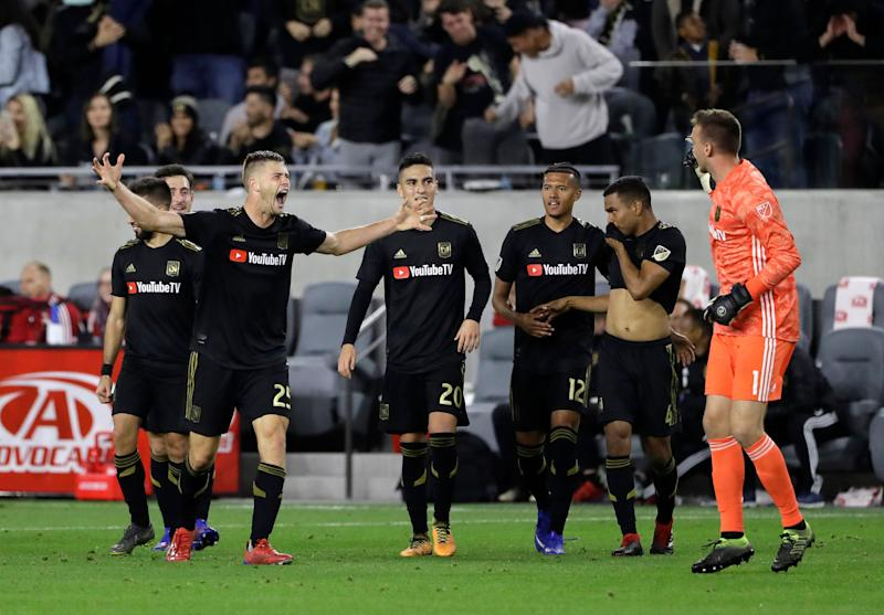 4e545c7efe4 Los Angeles FC's Walker Zimmerman, second from left, raises his arms in  celebration after