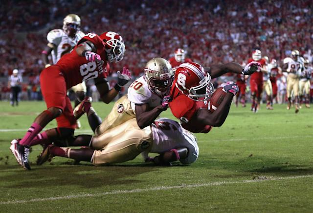 RALEIGH, NC - OCTOBER 06: Shadrach Thornton #10 of the North Carolina State Wolfpack dives for a touchdown as Lamarcus Joyner #20 of the Florida State Seminoles try to make a stop during their game at Carter-Finley Stadium on October 6, 2012 in Raleigh, North Carolina. (Photo by Streeter Lecka/Getty Images)