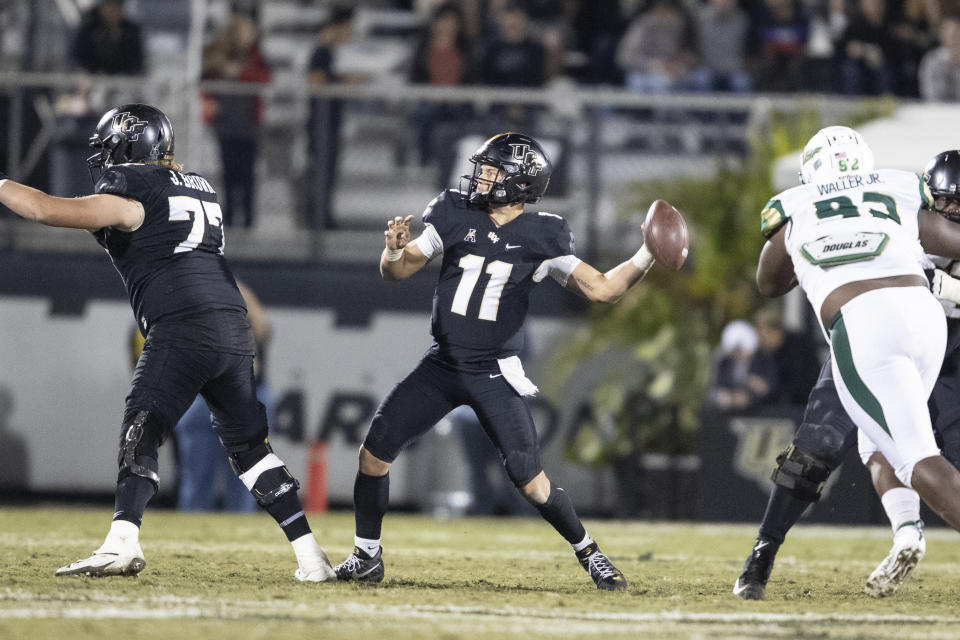 Central Florida quarterback Dillon Gabriel (11) prepares to throw the ball during the second half of an NCAA college football game against South Florida, Friday, Nov. 29, 2019, in Orlando, Fla. (AP Photo/Willie J. Allen Jr.)