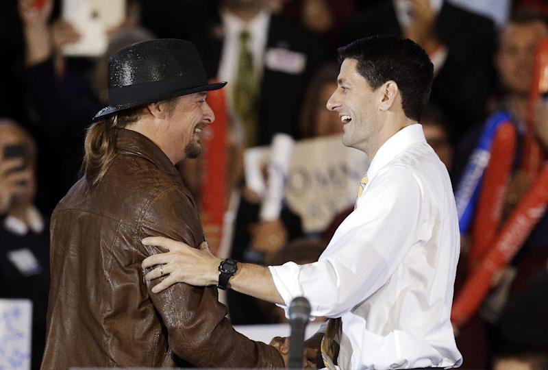 Republican vice presidential candidate, Rep. Paul Ryan, R-Wis., right,  is introduced by recording artist Kid Rock at a rally at Oakland University in Rochester, Mich., Monday, Oct. 8, 2012. (AP Photo/Paul Sancya)