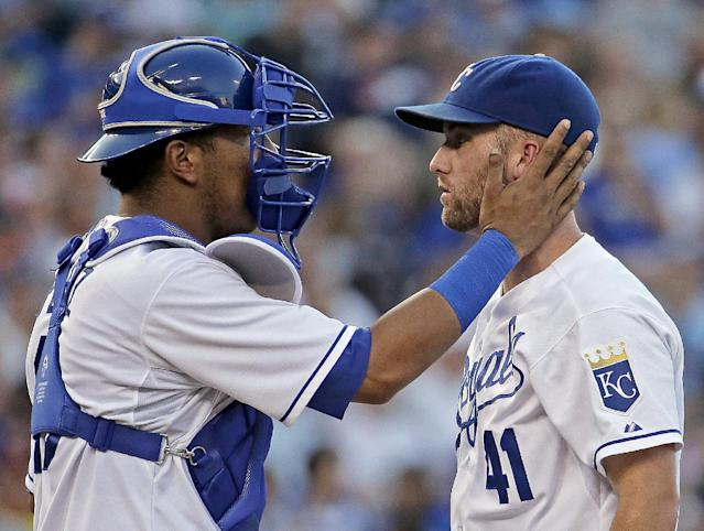 Kansas City Royals catcher Salvador Perez and starting pitcher Danny Duffy (41) meet on the mound during the third inning of a baseball game against the Detroit Tigers on Friday, July 11, 2014, in Kansas City, Mo. (AP Photo/Charlie Riedel)