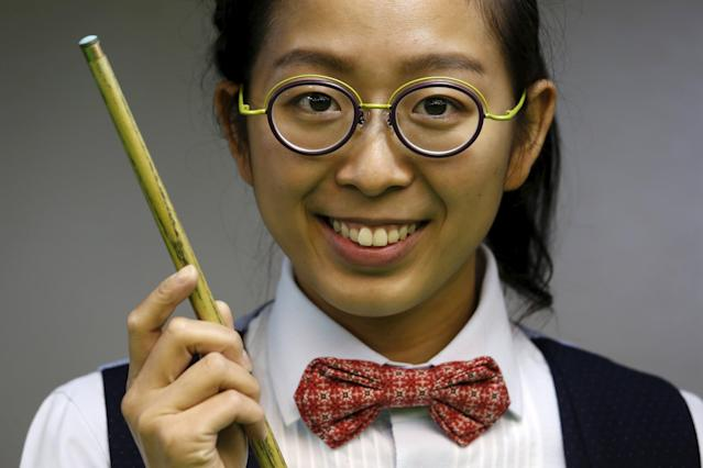 Ng On Yee, 25, 2015 Ladies World Snooker Championship winner, poses during an interview in Hong Kong, China January 27, 2016. A decade after taking up the sport because she liked her father's outfit, Hong Kong's Ng On Yee finds herself on the brink of snooker history as she embarks on a mission to reach the main draw of the men's world championships. Picture taken January 27, 2016. REUTERS/Bobby Yip