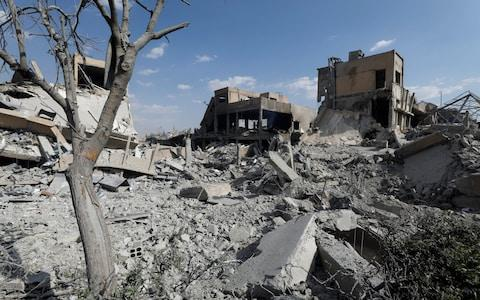 The destroyed Scientific Research Centre is seen in Damascus. Donald Trump said the attack was 'perfectly executed' - Credit: Omar Sanadiki/Reuters