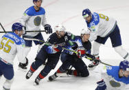 Colin Blackwell of the US, centre, and Jason Robertson of the US, centre right, in action during the Ice Hockey World Championship group B match between United States and Kazakhstan at the Arena in Riga, Latvia, Tuesday, May 25, 2021. (AP Photo/Sergei Grits)