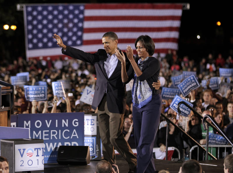 President Barack Obama and first lady Michelle Obama waves onstage during a rally at Ohio State University in Columbus, Ohio, Sunday, Oct. 17, 2010. (AP Photo/J. Scott Applewhite)
