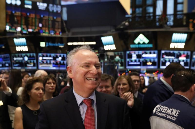 Xerox chief executive officer, Jeff Jacobson, smiles as he stands on the floor of the NYSE in New York