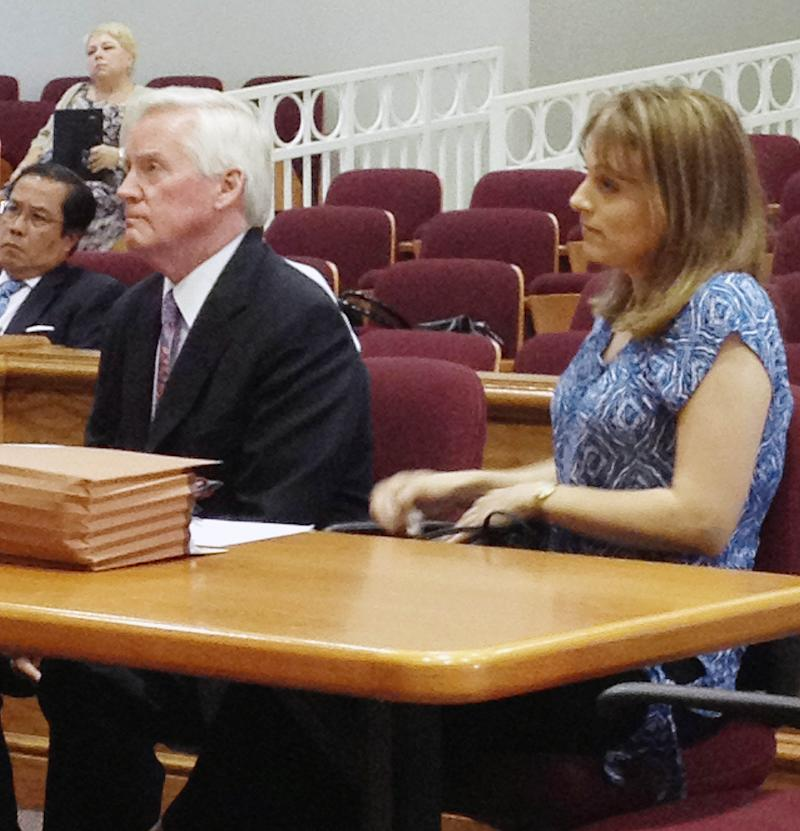 Torry Hansen, right, sits with her attorney  Ed Yarbrough, Friday, July 13, 2012, in Lewisburg, Tenn. Hansen, who ended her Russian adoption by sending the 7-year-old boy to Moscow on a plane by himself has lost her bid to get a judge to set aside an order that she pay child support. (AP Photo/Kristin M. Hall)