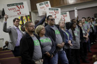 "In this Sunday, Nov. 3, 2019, photo, people wearing ""Save The Paseo"" shirts stand among attendees at a rally to keep a street named in honor of Dr. Martin Luther King Jr. at Paseo Baptist Church in Kansas City, Mo. In January, the City Council voted to rename one of the city's main boulevards, The Paseo, after King, but many in the community want the old name back. A petition drive put the issue on the Nov. 5 ballot pitting neighbors against each other. (AP Photo/Charlie Riedel)"