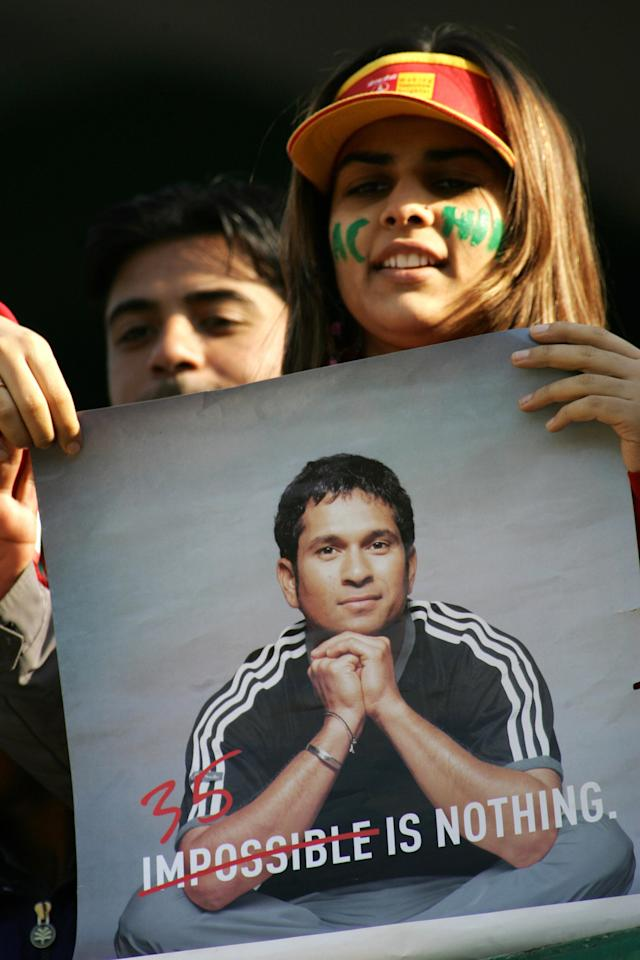 New Delhi, INDIA:  An Indian supporter holds a poster of Indian cricketer Sachin Tendulkar during the second day of the second Test against Sri Lanka at the Ferozeshah Kotla ground in New Delhi 11 December 2005.  Sri Lanka were 198-6 in their first innings at stumps in reply to India's 290.   AFP PHOTO/ Manpreet ROMANA  (Photo credit should read MANPREET ROMANA/AFP/Getty Images)