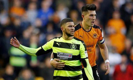Britain Football Soccer - Wolverhampton Wanderers v Huddersfield Town - Sky Bet Championship - Molineux - 25/4/17Wolves' Danny Bath in action with Huddersfield Town's Nahki Wells Mandatory Credit: Action Images / Andrew CouldridgeLivepic