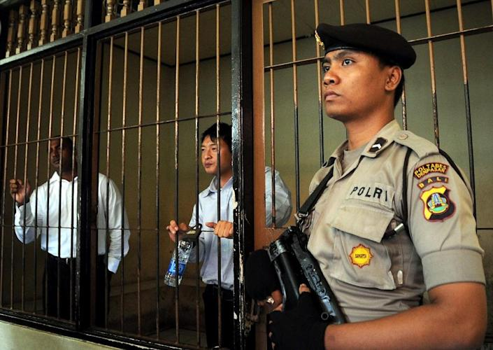 Australians Myuran Sukumaran (L) and Andrew Chan (C), members of the Bali Nine gang, shown here in 2010, have been taken from their Bali prison to Nusakambangan island, home to several high-security prisons, where they will likely be executed (AFP Photo/Sonny Tumbelaka)