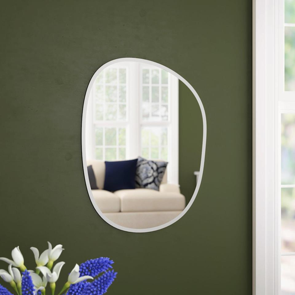 <p>This <span>Wrought Studio Klaudia Frameless Asymmetrical Wall Mirror</span> ($89, originally $100) will make a great minimal addition to your space.</p>