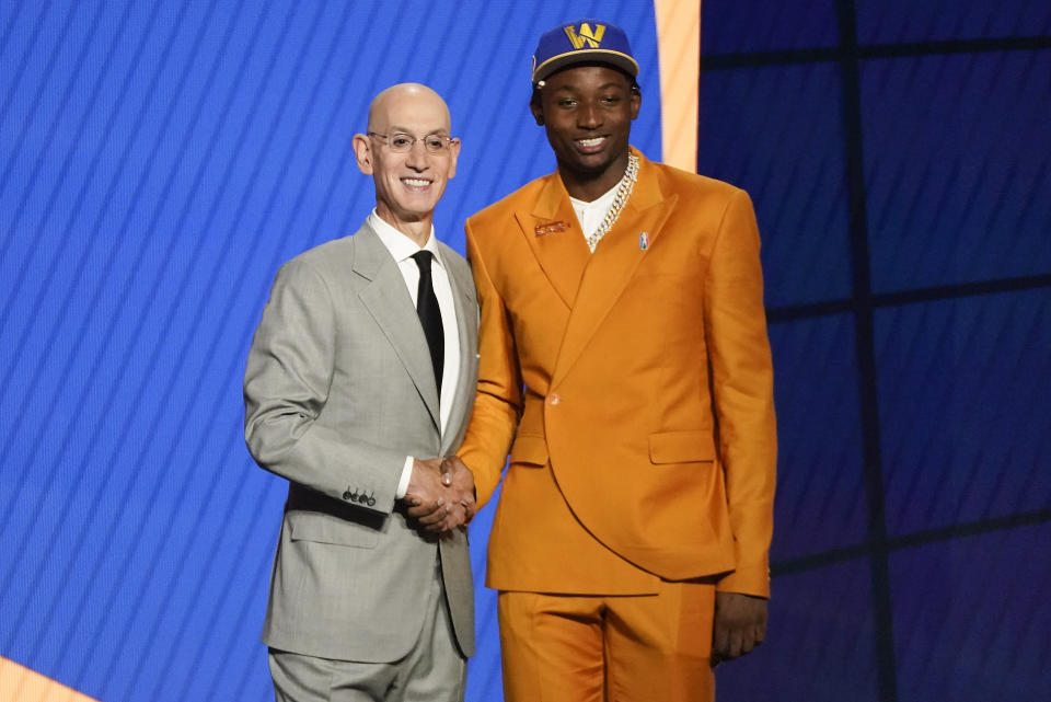 Jonathan Kuminga, right, poses for a photo with NBA Commissioner Adam Silver after being selected seventh overall by the Golden State Warriors during the NBA basketball draft, Thursday, July 29, 2021, in New York. (AP Photo/Corey Sipkin)