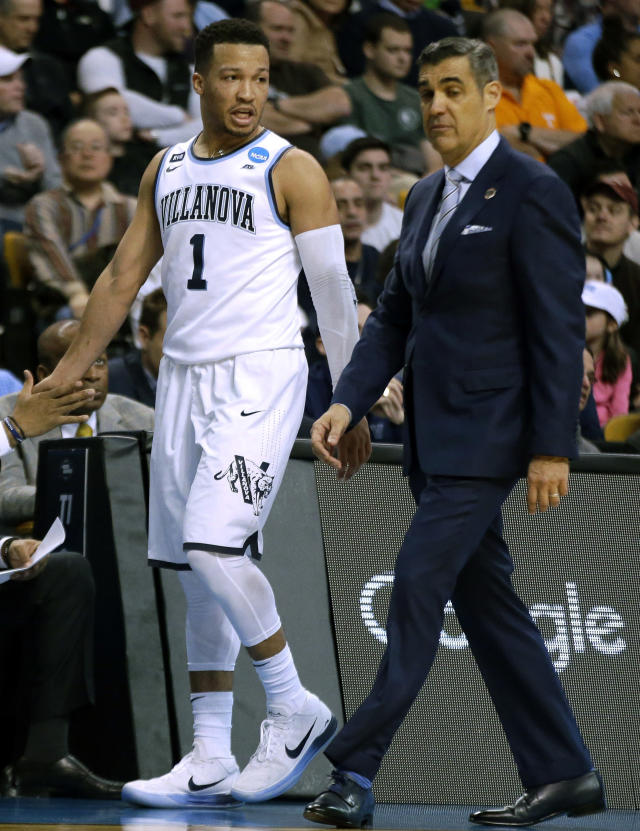 Villanova's Jalen Brunson, left, walks with head coach Jay Wright during the first half of an NCAA men's college basketball tournament regional final against Texas Tech, Sunday, March 25, 2018, in Boston. (AP Photo/Elise Amendola)