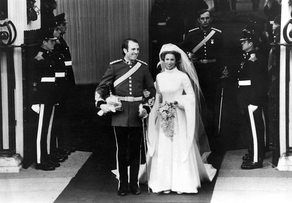 Princess Anne wore a high-neck dress by Maureen Baker to wed Mark Phillips in November 1973. (Getty Images)