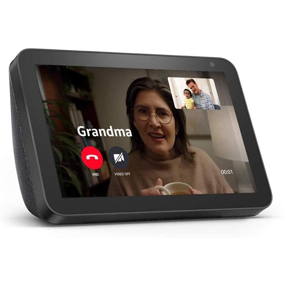 """Especially in times like these video calls are all the more important, the Echo Show 8 is a near-perfect gift for extended family members. (We say """"near-perfect"""" because the perfect gift is seeing your loved ones in person.) When they're not chatting away through the eight-inch HD screen, they have access to all of the typical Alexa-compatible features, like watching shows, listening to a rundown of the news or music, updating to-do lists, and adjusting smart lights. It's also a great way to display photos while they're not using it, and it even has a built-in shutter to cover the camera for extra peace of mind. <br> <br> <strong>$105</strong> (<a href=""""https://www.amazon.com/Echo-Show-8/dp/B07PF1Y28C"""" rel=""""nofollow noopener"""" target=""""_blank"""" data-ylk=""""slk:Shop Now"""" class=""""link rapid-noclick-resp"""">Shop Now</a>)"""