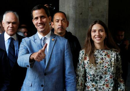 Venezuelan opposition leader Juan Guaido, who many nations have recognized as the country's rightful interim ruler, attends a meeting with students in Caracas
