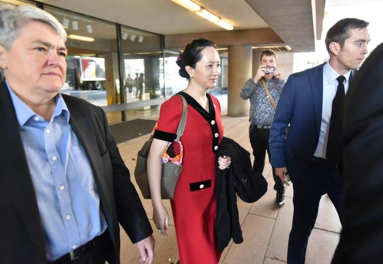 Huawei chief financial officer Meng Wanzhou (C) was arrested in 2018 during a flight stopover in Vancouver on a US warrant alleging violations of sanctions against Iran