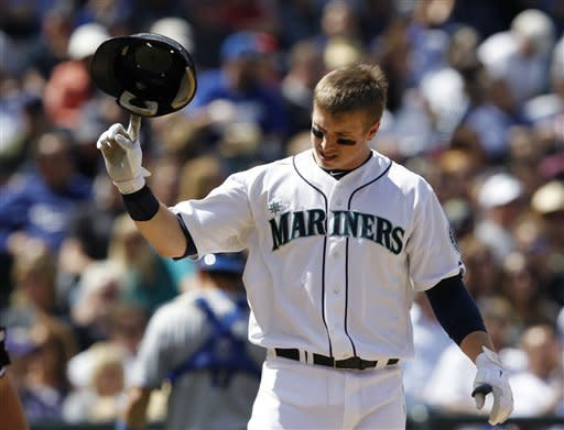 Seattle Mariners' Justin Smoak tosses his helmet after striking out against the Los Angeles Dodgers in the sixth inning of a baseball game on Sunday, June 10, 2012, in Seattle. (AP Photo/Elaine Thompson)