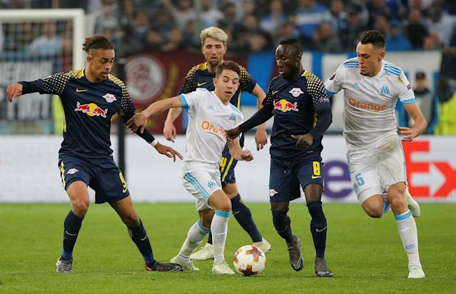 Soccer Football - Europa League Quarter Final Second Leg - Olympique de Marseille v RB Leipzig - Orange Velodrome, Marseille, France - April 12, 2018 RB Leipzig's Naby Keita and Yussuf Poulsen in action with Marseille's Lucas Ocampos and Maxime Lopez REUTERS/Jean-Paul Pelissier
