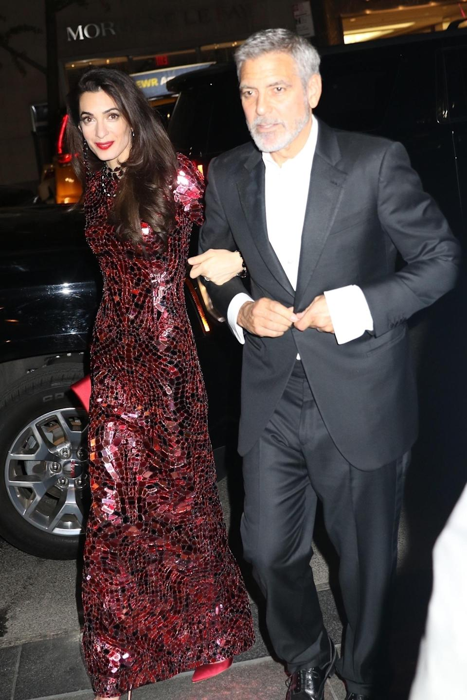<p>George Clooney and Amal Clooney were spotted returning to their hotel after the MET Gala festivities in New York City. (Photo: Backgrid) </p>
