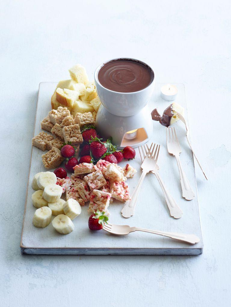 "<p>Fondue is always a fun time. Whip up a savory or sweet plate and gather round with friends to reminisce about the past 50 years. </p><p><strong><a href=""https://www.thepioneerwoman.com/food-cooking/cooking-tips-tutorials/a82201/rice-krispie-fondue/"" rel=""nofollow noopener"" target=""_blank"" data-ylk=""slk:Get the recipe"" class=""link rapid-noclick-resp"">Get the recipe</a>.</strong></p><p><strong><a class=""link rapid-noclick-resp"" href=""https://go.redirectingat.com?id=74968X1596630&url=https%3A%2F%2Fwww.walmart.com%2Fip%2FOster-Titanium-Infused-Dura-Ceramic-3-Qt-Fondue-Pot-Black%2F43223461&sref=https%3A%2F%2Fwww.thepioneerwoman.com%2Fhome-lifestyle%2Fentertaining%2Fg34192298%2F50th-birthday-party-ideas%2F"" rel=""nofollow noopener"" target=""_blank"" data-ylk=""slk:SHOP FONDUE POTS"">SHOP FONDUE POTS</a><br></strong></p>"