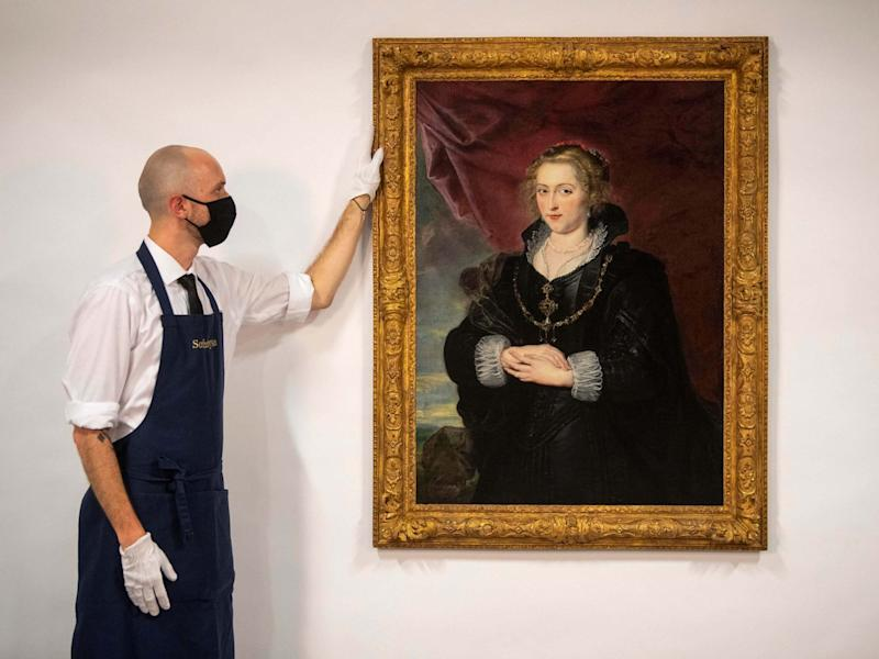 A Sotheby's technician with the Rubens portrait, which was until recently hidden away in a private collection, unknown for much of the 20th century: PA