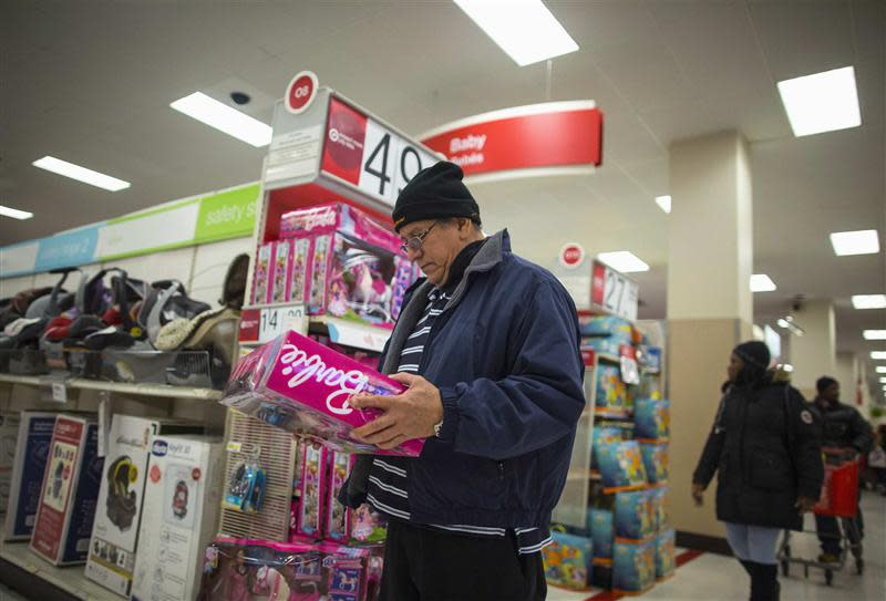 People shop at a Target store during Black Friday sales in the Brooklyn borough of New York
