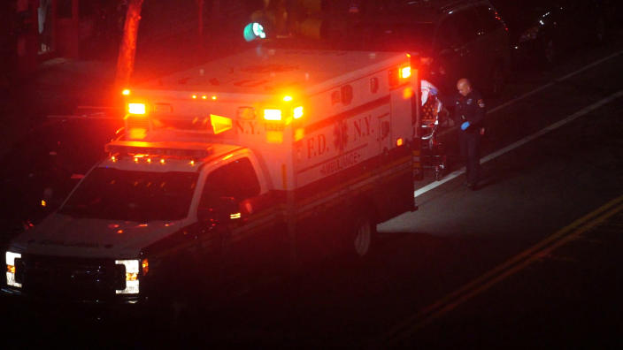 In this Thursday, April 2, 2020, image made from video, a person is taken into an ambulance in the Brooklyn borough of New York. The sounds of sirens can be heard prominently in the city, where the number of deaths due to the new coronavirus continues to climb. (AP Photo/Emily Leshner)