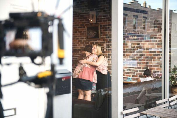PHOTO: Congressional candidate Liuba Grechen Shirley hugs a supporter while filming an campaign ad on July 24, 2018, at a local coffee shop. (Michael Noble, Jr./The Washington Post via Getty Images)