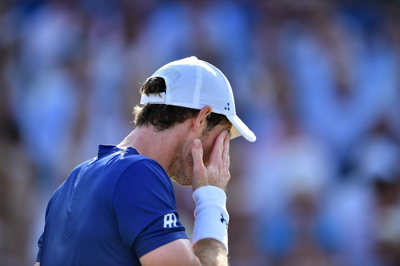 Britain's Andy Murray reacts against Australia's Jordan Thompson during their men's singles first round tennis match at the ATP Aegon Championships tennis tournament at Queen's Club in west London on June 20, 2017.Murray lost the match 6-7, 2-6. (AFP Photo/GLYN KIRK)