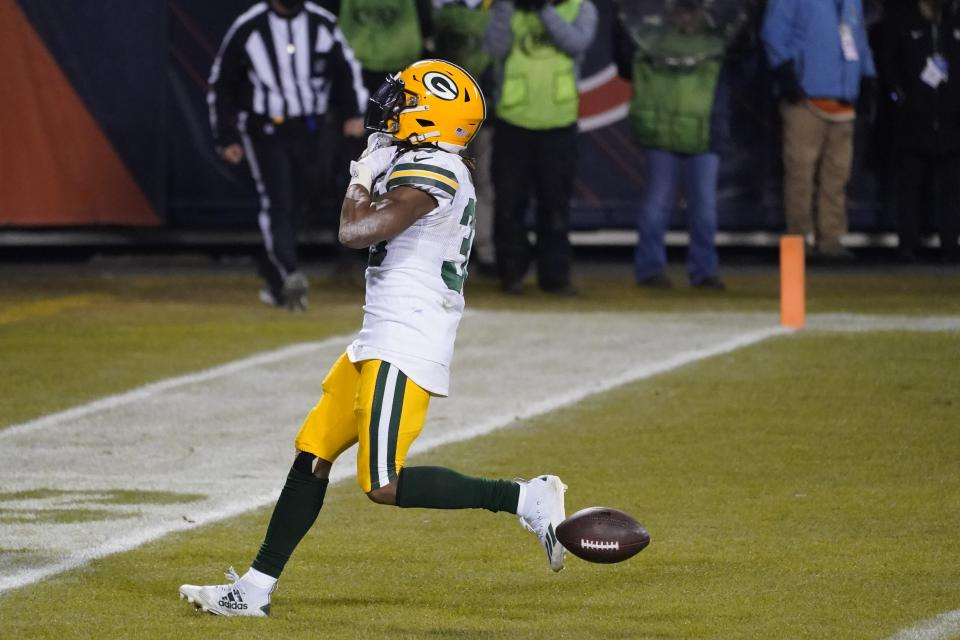 Green Bay Packers' Aaron Jones reacts after running for a touchdown during the second half of an NFL football game against the Chicago Bears Sunday, Jan. 3, 2021, in Chicago. (AP Photo/Nam Y. Huh)