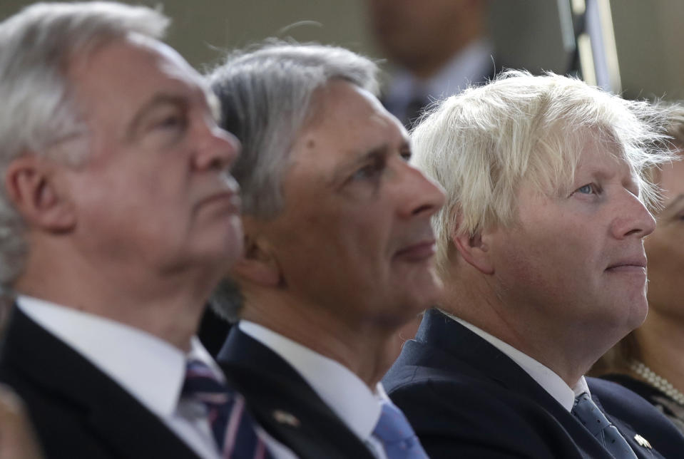 From left, Britain's chief Brexit negotiator David Davis, Chancellor of the Exchequer Philip Hammond and Foreign Secretary Boris Johnson attend a speech by Prime Minister Theresa May, in Florence, Italy, Friday Sept. 22, 2017. May will try Friday to revive foundering Brexit talks — and unify her fractious government — by proposing a two-year transition after Britain's departure from the European Union in 2019 during which the U.K. would continue to pay into the bloc's coffers. (AP Photo/Alessandra Tarantino, Pool)