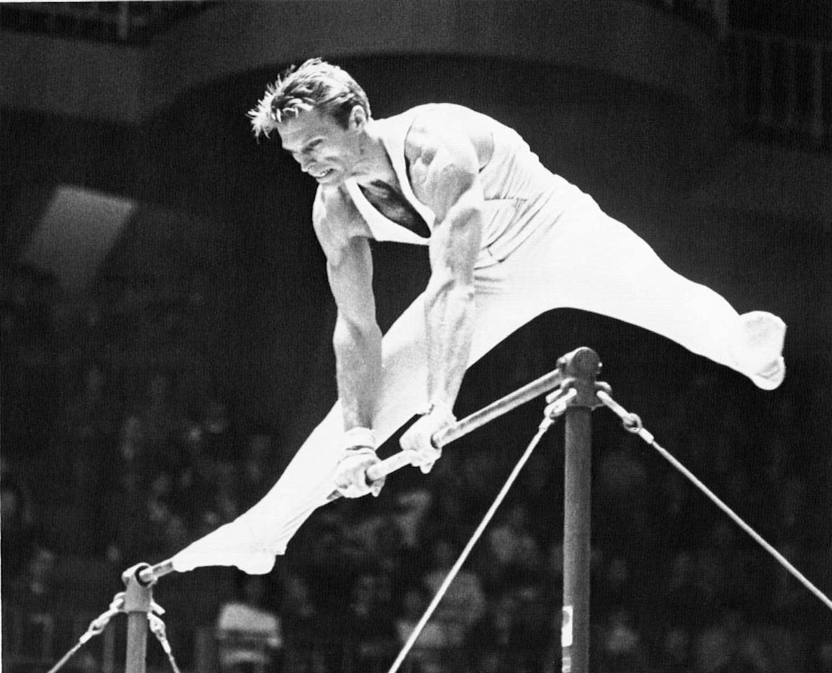 Russia's Boris Shakhlin appears to be poised above the bar during competition Oct. 23, 1964, in the gymnastic horizontal bar event of the Olympic games in Tokyo. He won a gold medal. (AP Photo)