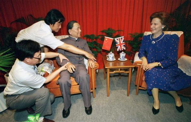 "Artists from China install wax figures of late Chinese paramount leader Deng Xiaoping and former British Prime Minister Margaret Thatcher at the Hong Kong Museum of History, June 30, 1998 one day before the first anniversary of the territory's handover to Chinese rule. The scene, entitled ""The Historic Moment"", depicts the talks between the two leaders on September 14, 1982 in Beijing on the subject of China resuming the exercise of sovereignty over Hong Kong."